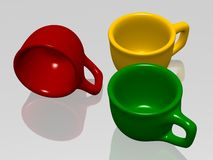 Three color cups. Color cups on a table Stock Images