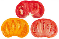 Three color cut tomatoes. Three color ripe cut tomatoes Royalty Free Stock Photography