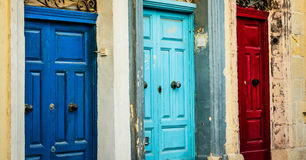 Three color doors in a street of Valletta Royalty Free Stock Photos