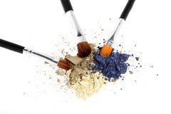 Three-color eyeshadow with brushes on white Royalty Free Stock Photo