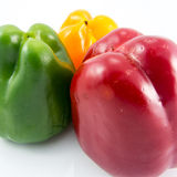 Three color fresh capsicum on white. Background Royalty Free Stock Photos