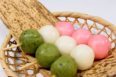 Three-color group that was wrapped in bamboo basket and Takesasa in Hinamatsuri royalty free stock images