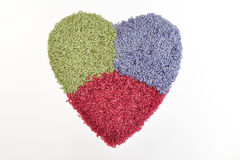 Three color  herbal rice in heart shape Stock Photos