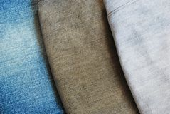 Three color jeans pile background texture Royalty Free Stock Photography