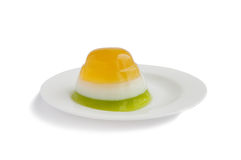 Three color jelly on white plate Royalty Free Stock Images