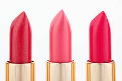 Three color lipsticks arranged in line Stock Photography