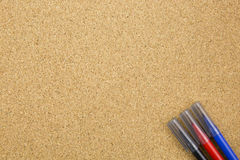 Three color marker on cork board Royalty Free Stock Image