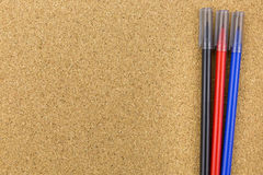 Three color marker on cork board Royalty Free Stock Photos