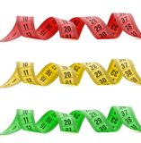 Three color measuring tapes Stock Photography