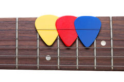 Three color mediators on a guitar fingerboard Stock Photography