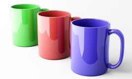 Three color mugs over white Royalty Free Stock Images