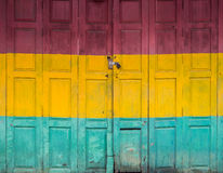 Three color old door. Three color horizotal old door front house Royalty Free Stock Photos