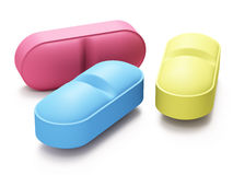 Three color pills. On white background Royalty Free Stock Photos