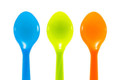 Three color plastic spoon Royalty Free Stock Photo