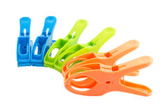 Three color plastic spring clamps isolated over white background Royalty Free Stock Images