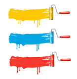Three color roller brushes. Stock Photo