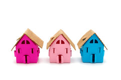 Three color small houses. Three color paper small houses on a white background Royalty Free Stock Images