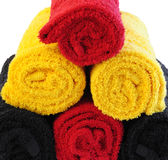 Three color towels in rolls Stock Images