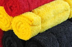 Three color towels in stock Royalty Free Stock Photo