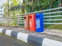 Three Color Trash Can On the Side of the Road. View of Three Color Trash Can On the Side of the Road Stock Photos