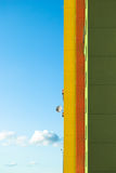 Three color wall and small satellite. Against sky Stock Photography