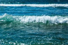 Three-color water of the Mediterranean Sea with big waves. Green. Three-color water near the beach of the Mediterranean Sea with big waves. Green, blue and dark stock photography