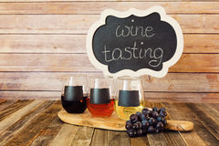 Three color wine flight in chalkboard glasses with a sign Royalty Free Stock Photos