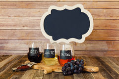 Three color wine flight in chalkboard glasses with a sign Royalty Free Stock Photo
