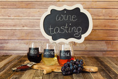 Three color wine flight in chalkboard glasses with a sign Stock Photography