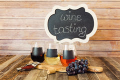 Three color wine flight in chalkboard glasses with a sign Stock Images