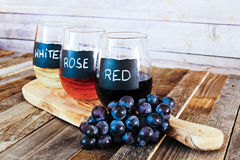 Three color wine flight in label glasses close up Royalty Free Stock Photos