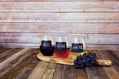 Three color wine flight in label glasses Stock Images