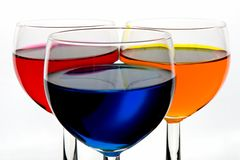 Three color wineglasses stock photography
