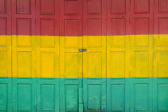 Three color of wood door. Red green and yellow color wooden door stock images