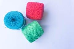 Three color of yarn stock photos