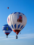 Three colored balloons in blue sky Royalty Free Stock Photo