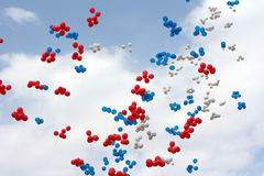 Three colored balloons in the sky. Red, blue and white colored balloons in the sky Royalty Free Stock Images