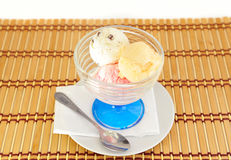 Three colored balls of ice cream. stock photo