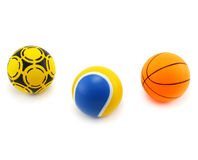 Three colored balls isolated on a white background. Three plastic colored balls (for playing handball, tennis, basketball) isolated on a white background Royalty Free Stock Photography