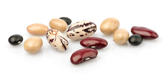 Three colored beans. On white background stock images