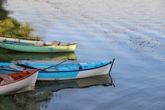 Three colored boats in water. Stock Photo