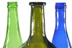 Three colored bottles Stock Images
