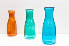 Three Colored Bottles. In white background Royalty Free Stock Photos
