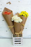 Three colored bouquet of carnations in paper cornet stock images