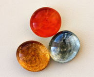 Three colored cabochon for needlework. The oval shape Royalty Free Stock Images