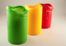 Three colored candles. Three colored large wax candles Royalty Free Stock Image