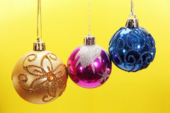 Three colored Christmas balls. Stock Photo