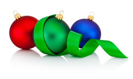 Three colored Christmas baubles with ribbon isolated on white Royalty Free Stock Image