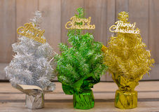 Three colored Christmas trees Stock Photo