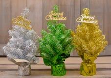 Three colored Christmas trees Stock Photo